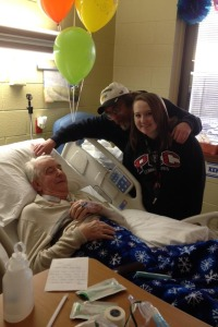 A picture of my daughter Haley, Dad and me, in acute Rehab